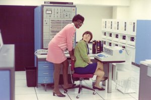 1970's~ Women working in technology with what is probably a room-sized computer.